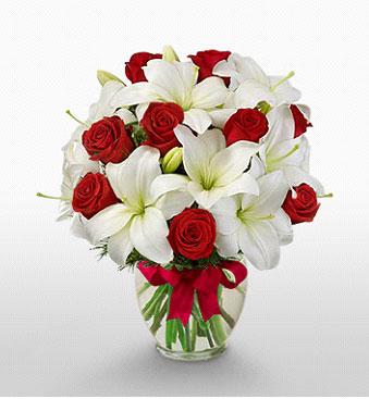Batman hediye çiçek yolla  1 dal kazablanka 11 adet kırmızı gül vazosu